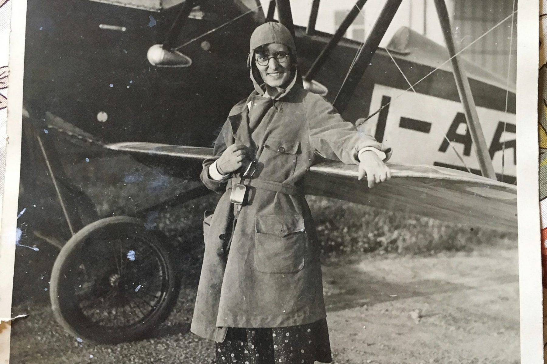 """Great-aunt Bice at her first flight Memories keep popping up. A black and white print featuring my Great-Aunt Bice on her first flight, July 13th 1930 (so says the caption on the back of the picture) at the airfield """"Gino Cima"""". Exactly 13 years later, during WW2, the airfield was bombed on the night of July 13th 1943, by the RAF."""