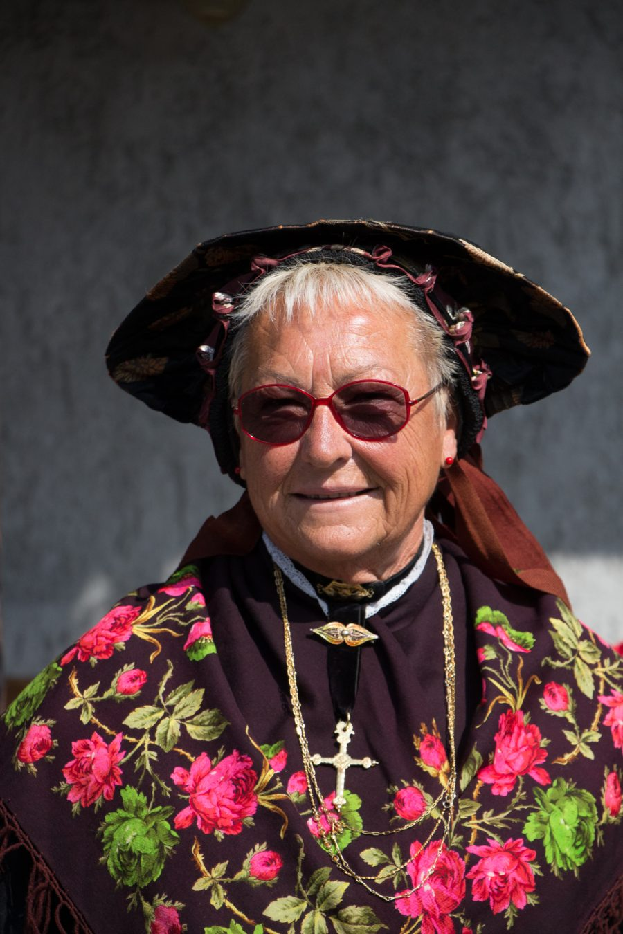 Lady in traditional dress for the festivity of Allevè, 2018