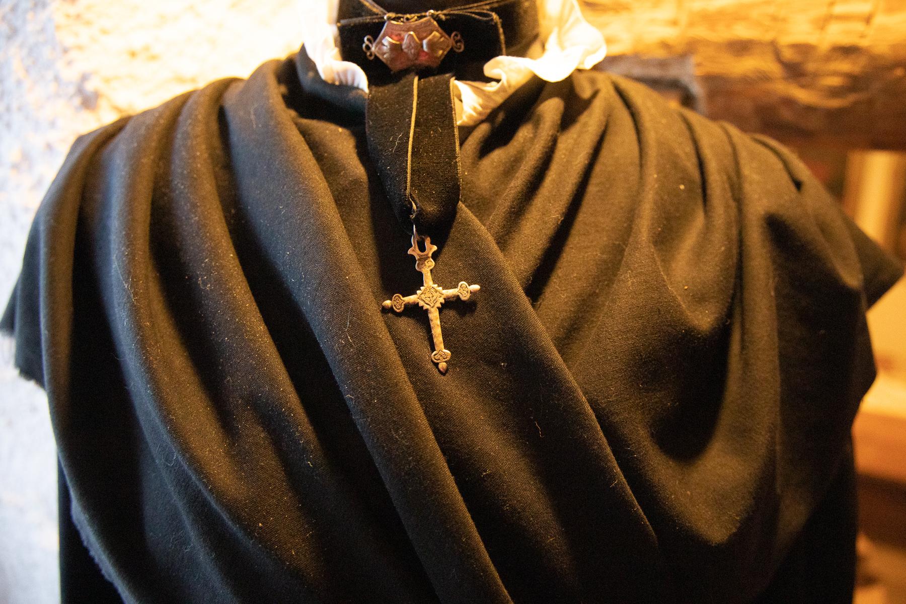 """Traditional dress and golden cross, at the """"Museo del Costume e delle Tradizioni Alpine"""", Pragelato, 2020"""
